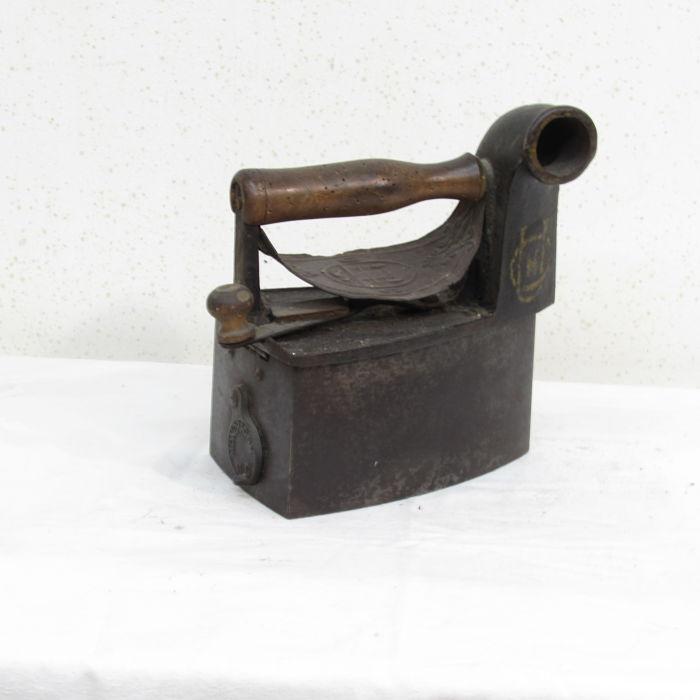 plancha antigua de carbón 231118